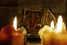 Framed picture of Goddess Lakshmi behind burning candles