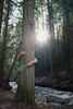 Arms wrapped around cedar tree