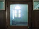 Chair in front of window seen through glass door